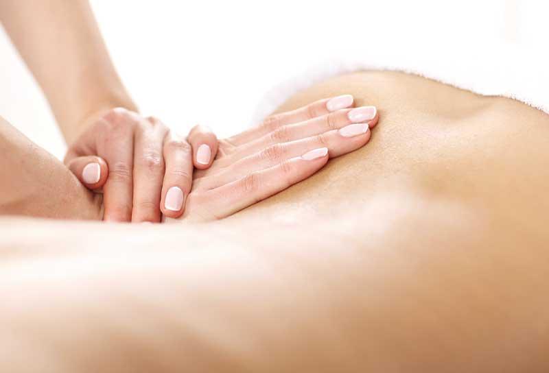 Patient receiving back massage